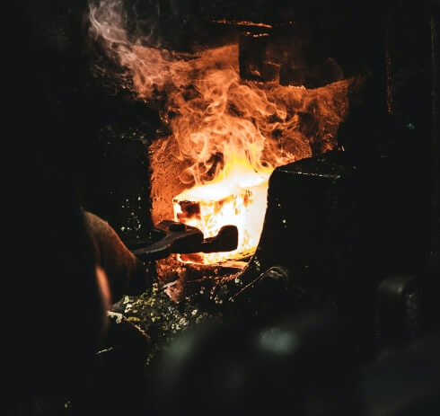 Blacksmith forging an ingot